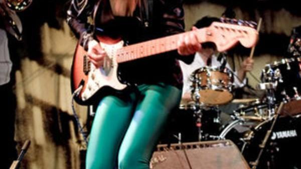 Nina-with-guitar.jpg